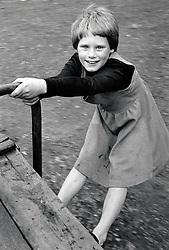 Girl in playground, Nottingham UK 1982