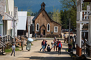 The Church of St Saviour is an Anglican Church of Canada erected in 1869 and preserved in Barkerville Historic Town & Park, British Columbia, Canada. Historically the main town of the Cariboo Gold Rush, Barkerville is now the largest living-history museum in Western North America. The town was named after Billy Barker from Cambridgeshire, England, who struck gold here in 1861, and his claim became the richest and the most famous. This National Historic Site nestles in the Cariboo Mountains at elevation 1200m (4000ft), at the end of BC Highway 26, 80 kilometres (50 mi) east of Quesnel. Gold here was first discovered at Hills Bar in 1858, followed by other strikes in 1859 and 1860. Wide publication of these discoveries in 1861 began the Cariboo Gold Rush, which reached full swing by 1865 following strikes along Williams Creek.