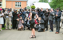 © Licensed to London News Pictures. 19/06/2014. Ascot, UK . Members of the press photograph a women wearing a hat. Day three, Ladies Day, at Royal Ascot 19th June 2014. Royal Ascot has established itself as a national institution and the centrepiece of the British social calendar as well as being a stage for the best racehorses in the world. Photo credit : Stephen Simpson/LNP