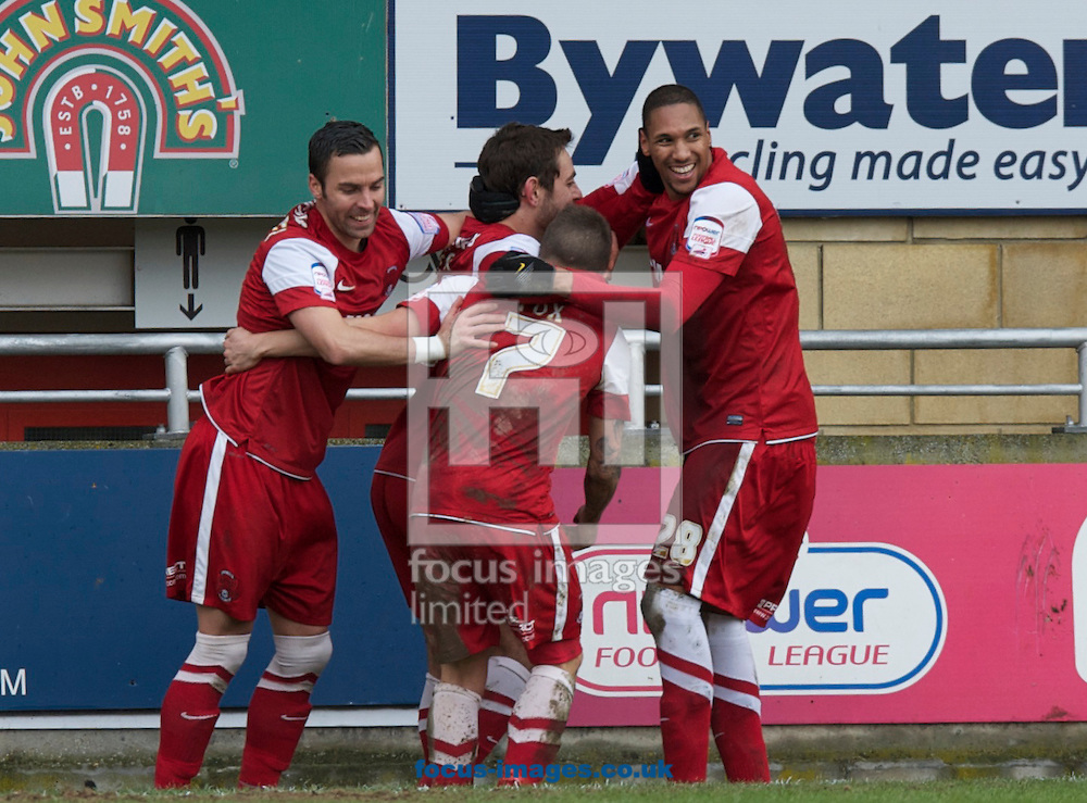 Picture by Alan Stanford/Focus Images Ltd +44 7915 056117.16/03/2013.(LtoR) Leon McSweeney Dean Cox and Shaun Batt of Leyton Orient congratulate Romain Vincelot during the npower League 1 match at the Matchroom Stadium, London..