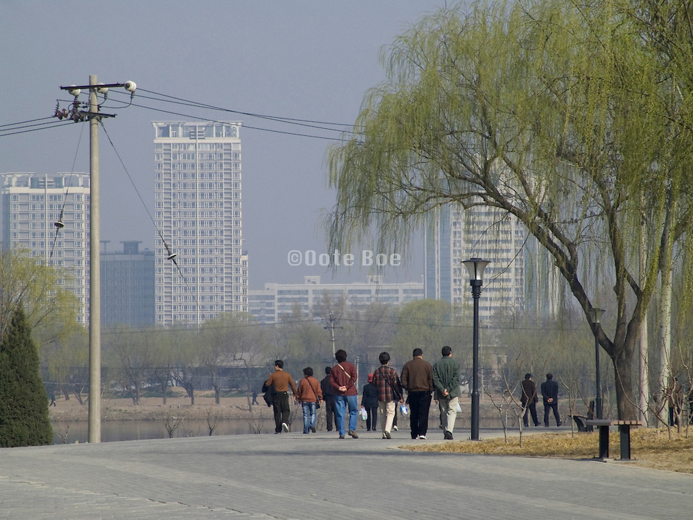 people enjoying there day off by taking a walk through the Chaoyang park Beijing China
