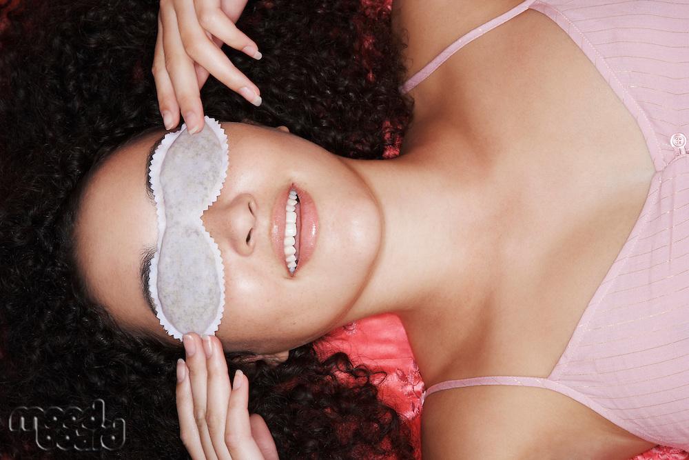 Teenage Girl Wearing Sleep Mask overhead view close-up