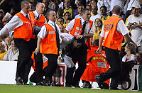 Photo: Ed Godden.<br /> Brazil v Wales. International Friendly. 05/09/2006.<br /> A Brazil fan is carried away after running onto the pitch.
