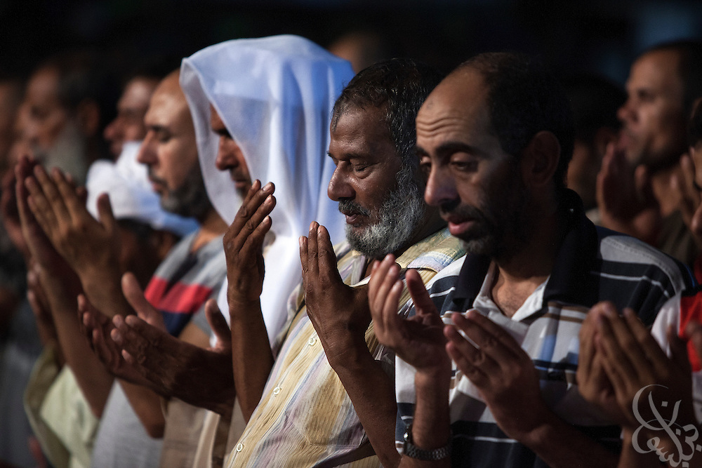 "Muslim Brotherhood members and other supporters of deposed Egyptian President take part in Fajr prayers Wednesday July 24, 2013 at their continuing sit-in protest camp in Rabia al-Adawiyya Square in the Nasr City district of Cairo, Egypt.  Pressure is building on the groups supporting the Muslim Brotherhood following a call by Egyptian Defense Minister, Gen. Abdel-Fattah el-Sissi for Egyptians to take to the streets on Friday July 26, 2013 to give him a mandate to fight ""terrorism""."