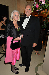 CHRIS & MEL COTTON he is Chief Executive of the Royal Albert Hall at a dinner hosted by the Royal Academy of Dance to present the Queen Elizabeth II Award 2014 held at Claridge's, Brook Street, London on 4th September 2014.