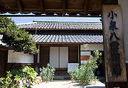 Photo shows the entranceway to  Lafcadio Hearn's home, which is located in a district just north of Matsue Castle that was mostly residences of the samurai in Matsue City, Shimane Prefecture, Japan on 26 June 2011.  Photographer: Robert Gilhooly