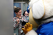 Haydon the Womble waving delivering Christmas presents to the children on behalf of AFC Wimbledon, at St George's Hospital, Tooting, United Kingdom on 13 December 2018.