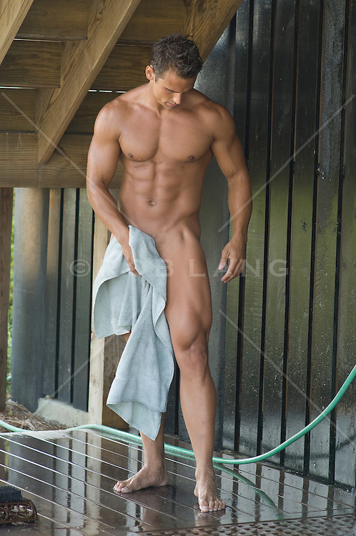 bodybuilder toweling off in an outdoor shower