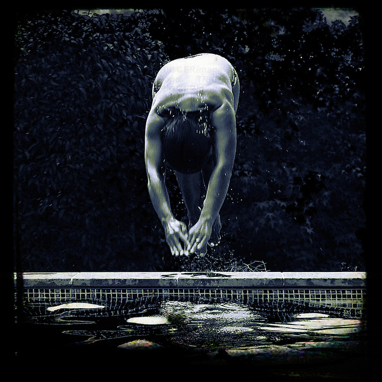 A man diving into a pool