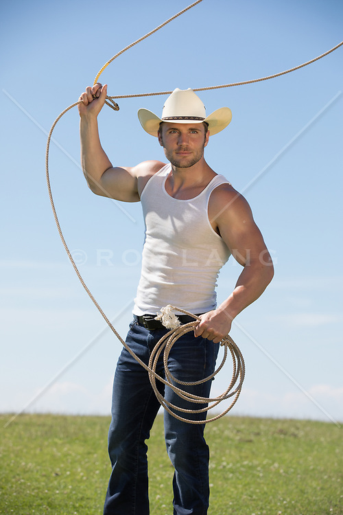 muscular cowboy roping outdoors
