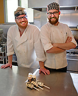 Seth Locken and Chris Wilkes, seen here Tuesday, July 15, 2014, in Fargo, N.D., are business partners with their ice cream enterprise known as Milkhaus. The two use regional ingredients to craft unique flavors like white chocolate lemon, chocolate lavender, toasted black sesame seed, and a proverbial favorite, bacon.<br /> Nick Wagner / The Forum