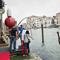 "VENICE, ITALY - JUNE 02: Finishing touches on ""Fishing Rabbit"" an installation by No2Good facing the Grand Canal and part of the Exhibition Future Pass on June 2, 2011 in Venice, Italy. The Venice Art Biennale will run from June 4 to November 27, 2011."