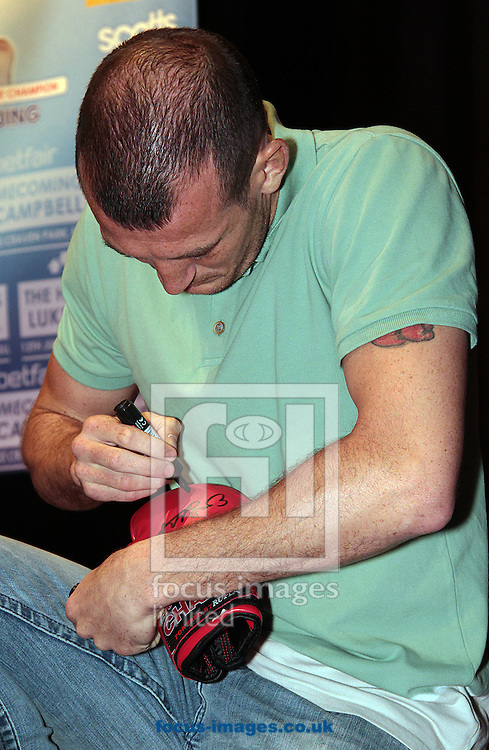 Picture by Richard Gould/Focus Images Ltd +44 7855 403186<br /> 22/06/2013<br /> Drew Mathews signs some boxing gloves pictured during a press conference at Hull City Hall.