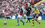 Ashley Westwood of Aston Villa on the ball during the The FA Cup match between Arsenal and Aston Villa at Wembley Stadium, London, England on 30 May 2015. Photo by Phil Duncan.