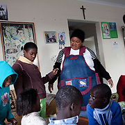 The Stars Foundation visiting Home from Home in Cape Town, South Africa...Beaullah, one of Home from Home's foster mothers at home with her children...Home from Home provide security for children who are either orphans or have been abandoned, neglected or abused . Many of the children have suffered severe abuse and more than half are HIV positive. Home from Home set up foster homes of no more than six children in local communities where there is a need and employ women to run the homes and become the registered foster mother of the children.