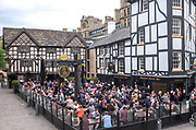 Crowds of drinkers atSinclairs Oyster Bar and The Old Wellington pub in  Manchester city centre