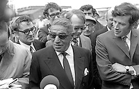 Greek shipping magnate, Aristotle Onassis, surrounded by Harland & Wolff personnel and journalists during a visit to the shipyard in Belfast, N Ireland, on 5th September 1970. Onassis is a 25% shareholder in the Belfast shipyard. 197009050347c<br />