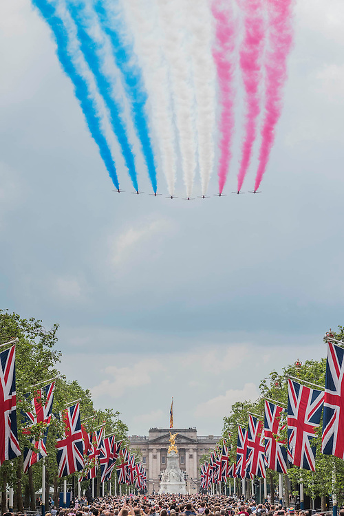 A flypast by the Red Arrows and other planes from the RAF down the Mall - Queens 90th birthday was celebrated by the traditional Trooping the Colour as well as a flotilla on the river Thames.