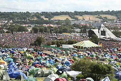 © Licensed to London News Pictures. 30/06/2019. Glastonbury , UK. A big crowd watch acts on the Pyramid stage on the last day of the Glastonbury Festival in Somerset. Photo credit: Jason Bryant/LNP