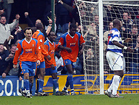 QPR V LUTON TOWN<br />PHOTO' S BY GERARD FARRELL<br />DATE:27/03/2004.<br />LUTON'S ENOCH SHOWUNMI CELEBRATES HIS GOAL AND GET BOOKED AT THE SAME TIME