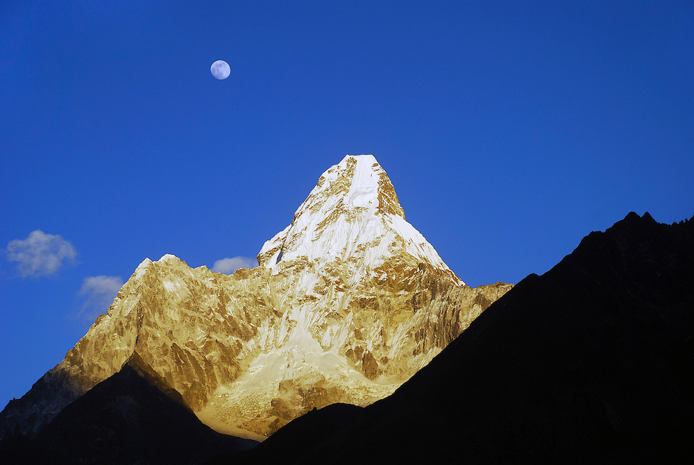Nepal, 2009.<br /> <br /> Sun setting and moon rising on Ama Dablam in the Solo Khumbu valley of Nepal. Everest region of the Himalayas