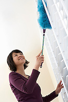 Woman dusting low angle view