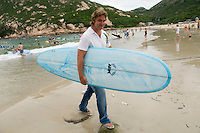 Australian Hong Kong-based Adam Healy owner of Ark Surfboards photographed on Shek-O beach in Hong Kong with one of Ark surfboard.