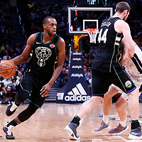 01 April 2018: Milwaukee Bucks forward Khris Middleton (22) drives past Denver Nuggets forward Juan Hernangomez (41) on a scene set by Milwaukee Bucks center Tyler Zeller (44) during the Denver Nuggets 128-125 victory over the Milwaukee Bucks, at the Pepsi Center, Denver, Colorado, USA.