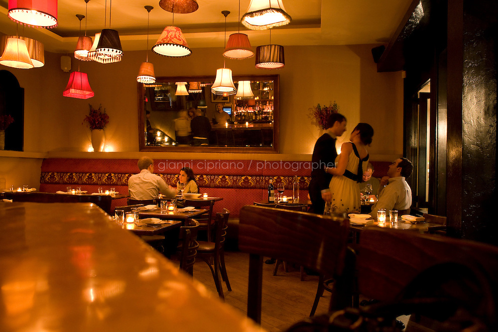 9 October, 2008. New York, NY. Customers have late dinner after midnight at Shorty's 32 Restaurant in Soho. Shorty's 32 has late night services some nights. <br /> <br /> ©2008 Gianni Cipriano for The New York Times<br /> cell. +1 646 465 2168 (USA)<br /> cell. +1 328 567 7923 (Italy)<br /> gianni@giannicipriano.com<br /> www.giannicipriano.com