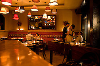9 October, 2008. New York, NY. Customers have late dinner after midnight at Shorty's 32 Restaurant in Soho. Shorty's 32 has late night services some nights. <br /> <br /> &copy;2008 Gianni Cipriano for The New York Times<br /> cell. +1 646 465 2168 (USA)<br /> cell. +1 328 567 7923 (Italy)<br /> gianni@giannicipriano.com<br /> www.giannicipriano.com