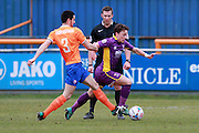 Sam Habergham chases down Jack Munns during the Vanarama National League match between Braintree Town and Cheltenham Town at the Amlin Stadium, Braintree, United Kingdom on 19 March 2016. Photo by Carl Hewlett