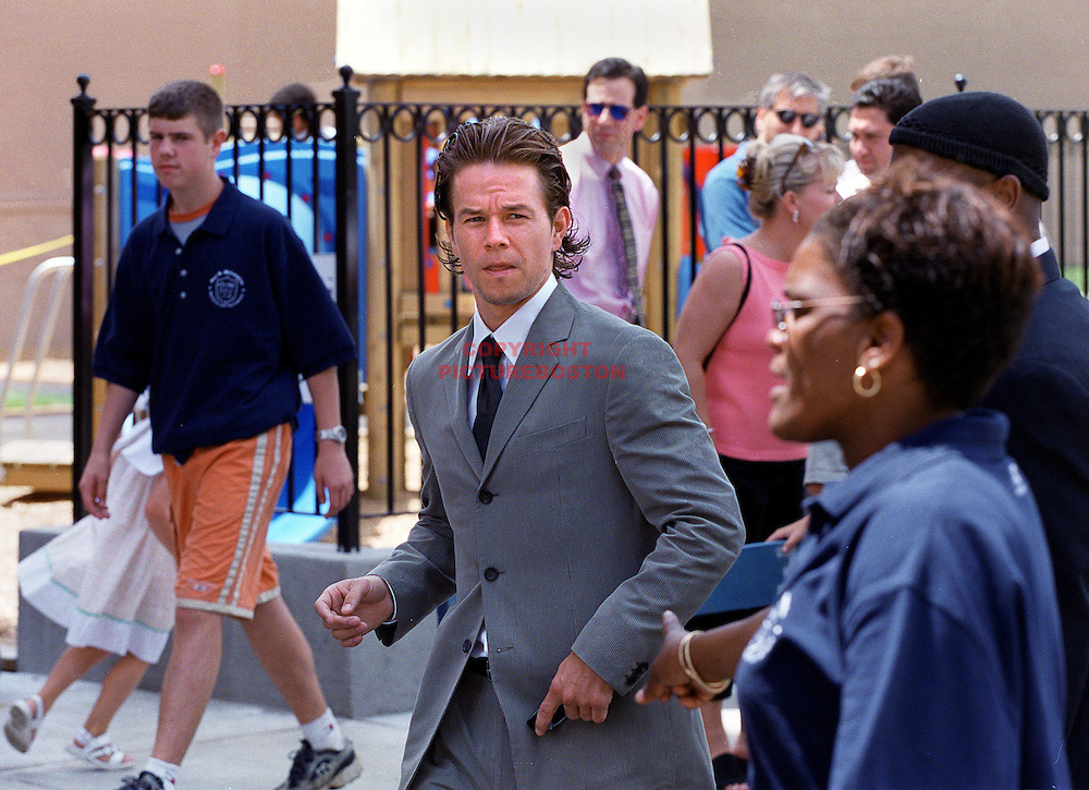 """RECONNECTING WITH THE PAST"" LOCAL BOSTON HERO/MOVIE ACTOR MARK WAHLBERG SPENDS SOME TIME WITH KIDS FROM HIS OLD HANG OUT, THE DANIEL MARR BOYS AND GIRLS CLUB JUNE24'00 AT THE GRAND OPENING OF PAUL R. MCLAUGHLIN YOUTH CENTER IN DORCHESTER(section of Boston). (IN HONOR OF THE LATE (MURDERED) PROSECUTER MCLAUGHLIN. ACCORDING TO MANY SOURCES AT THE CLUB, WAHLBERG WAS THE LAST KID TO BE KICKED OUT OF THE CLUB.."