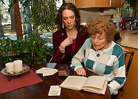 "Tamara McGonagle and Judy Buswell read through the journals of Anna Samson Bradley in preparation for their upcoming performance of ""I Have Been Busy All Day"" depicting Bradley's life as a housewife and mother during the 1890's.   (Karen Bobotas/for the Laconia Daily Sun)"