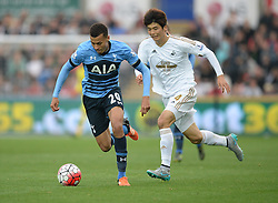 Dele Alli of Tottenham Hotspur attacks in the swansea half under pressure from Ki Sung-Yueng of Swansea City - Mandatory byline: Alex James/JMP - 07966 386802 - 04/10/2015 - FOOTBALL - Liberty stadium - Swansea, England - Swansea City  v Tottenham hotspur - Barclays Premier League