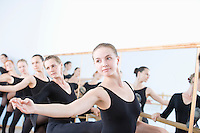 Women practising at the barre