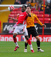 Photo: Leigh Quinnell/Sportsbeat Images.<br /> Charlton Athletic v Hull City. Coca Cola Championship. 22/12/2007. Charltons Lloyd Sam shields the ball from Hulls Bryan Hughes.