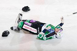 Nejc Berlisk of Olimpija injured during ice-hockey match between HDD Tilia Olimpija and HK Acroni Jesenice in 26th Round of EBEL league, on December 10, 2010 at Hala Tivoli, Ljubljana, Slovenia.(Photo By Vid Ponikvar / Sportida.com)