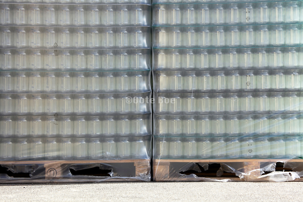 glass preserve jars stacked on a pallet