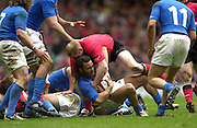 27/03/2004  -  RBS Six Nations Championship 2004 Wales v Italy.Italy's scrum half, Paul Griffen and Welsh Full Back contest the ball.   [Mandatory Credit, Peter Spurier/ Intersport Images].