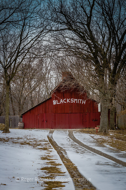 blacksmith red barn with snowy tracks sunset hodge park