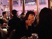 Jeune femme, &quot; Chez Prune&quot;, rue Beaurepaire, Paris, Paris-Ile-de-France, France.<br /> Young woman, caf&eacute; &quot;Chez Prune&quot;, street of Beaurepaire, town of Paris, Paris-Ile-de-France region, France.