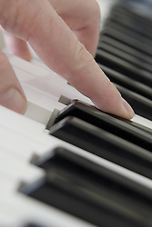 July 21, 2019 - Close Up Of Finger Playing Piano Keyboard (Credit Image: © John Short/Design Pics via ZUMA Wire)