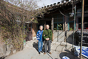 Mr and Mrs Wu in the yard outside their home in the Hutongs area, Beijing, China