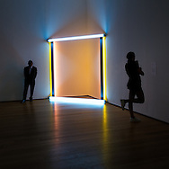 "untitled (to the ""innovator"" of Wheeling Peachblow) 1968 by Dan Flavin (American, 1933-1996) Flavin began to use commercially available fluorescent light tubes in 1963. This work marries color and light, bringing them into three dimensions.In dialogue with the surrounding space, the vertical and horizontal tubes both illuminate and obscure the corner - a location not typicallly used for displaying art. Though the emitted light transcends its physical encasement and transforms the surrounding space, Flavin avoided characterizing his work as sublime and instead considered his light installations ""situations"" or proposals. ""One might not think of light as a matter of facts, but I do,"" he stated. ""And it is...as plain and open and direct an art as you will ever find."""