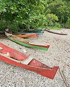 Colorful boats along a beach on Banda Besar