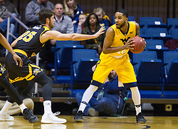 Dec 23, 2016; Morgantown, WV, USA; West Virginia Mountaineers guard Tarik Phillip (12) looks to pass while defended by Northern Kentucky Norse guard Cole Murray (25) during the first half at WVU Coliseum. Mandatory Credit: Ben Queen-USA TODAY Sports