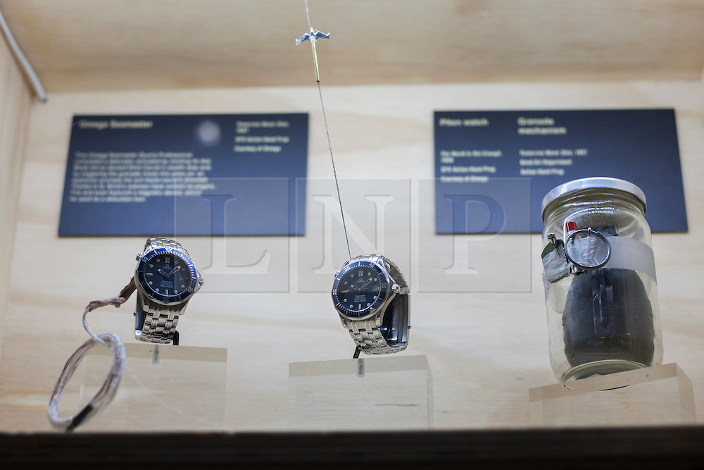© licensed to London News Pictures. London, UK 05/07/2012. The Omega watches, which have been used in Tomorrow Never Dies, being shown with many Bond items which have been used in the movies in the last 50 years at Designing 007 exhibition at Barbican Centre. Photo credit: Tolga Akmen/LNP