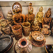 Some of the Maya artifacts on display in the museum at Radio Peten Island. Off the western side of the island of Flores is another much smaller island known simply as Radio Peten after the radio station that has broadcast from there since 1947. There are only a handful of buildings on the island, one of which is a small, one-room museum of Maya artifacts and various radio, telephone, and other artifacts. The only way to approach the island is by boat.