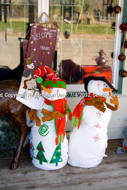 Two happy snowmen. Garden Gate at Crabtree's, Marine on Saint Croix Minnesota MN USA