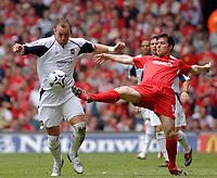 Photo: Daniel Hambury.<br /> Liverpool v West Ham United. The FA Cup Final. 13/05/2006.<br /> West Ham's Dean Ashton and Liverpool's Xabi Alonso battle.